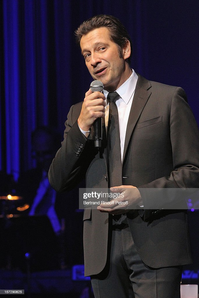 French impersonator Laurent Gerra imitates singer Patrick Bruel during his One Man Show at Palais des Congres on November 29, 2012 in Paris, France.