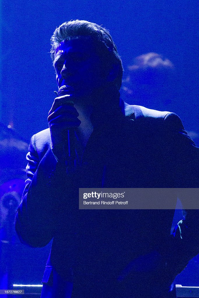 French impersonator Laurent Gerra imitates singer Serge Gainsbourg during his One Man Show at Palais des Congres on November 29, 2012 in Paris, France.