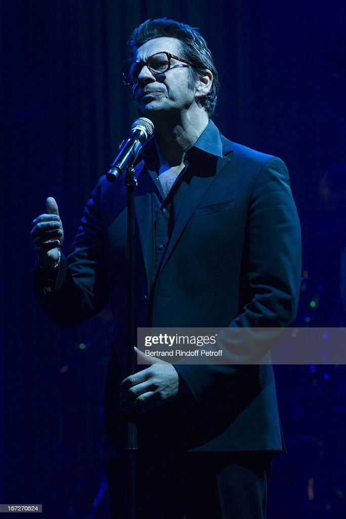 French impersonator <a gi-track='captionPersonalityLinkClicked' href=/galleries/search?phrase=Laurent+Gerra&family=editorial&specificpeople=538435 ng-click='$event.stopPropagation()'>Laurent Gerra</a> imitates singer Serge Reggiani during his One Man Show at Palais des Congres on November 29, 2012 in Paris, France.