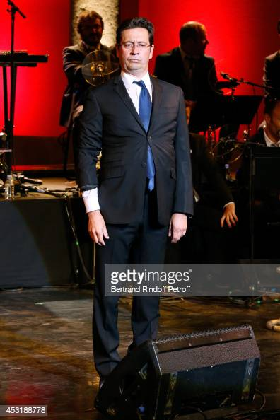 French impersonator Laurent Gerra is pictured while imitating Francois Hollande during his show at the 30th Ramatuelle Festival Day 4 on August 4...