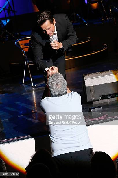 French impersonator Laurent Gerra is pictured with Enrico Macias while imitating Enrico Macias during his show at the 30th Ramatuelle Festival Day 4...
