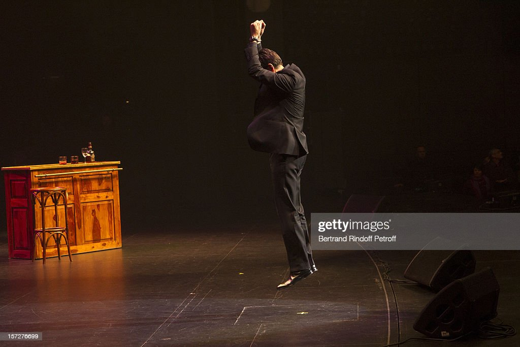 French impersonator Laurent Gerra jumps to give a rythm signal to his musicians during his One Man Show at Palais des Congres on November 29, 2012 in Paris, France.