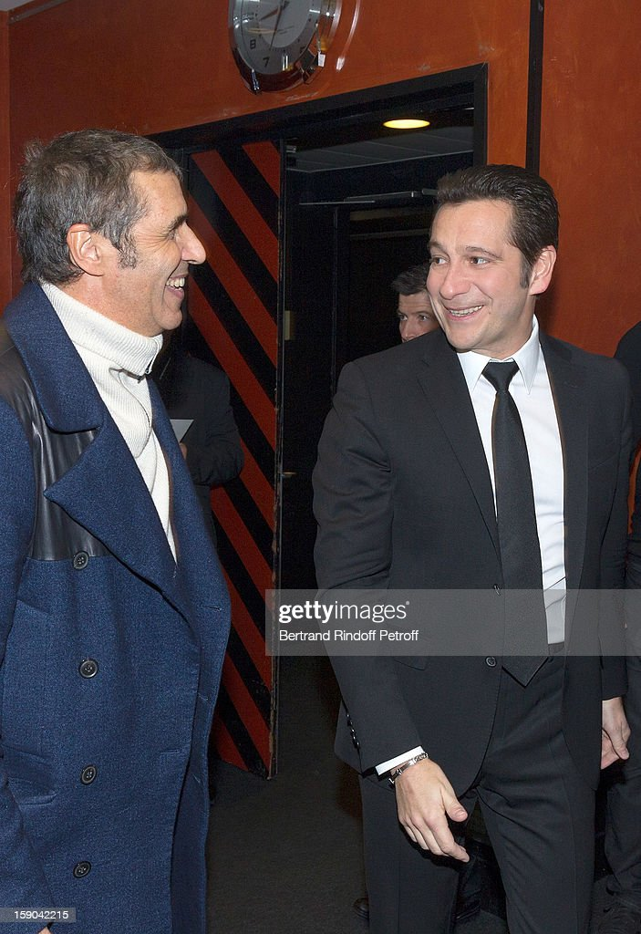French impersonator Laurent Gerra (L) meets with Julien Clerc prior to Gerra's one man show of at Olympia hall on January 5, 2013 in Paris, France.