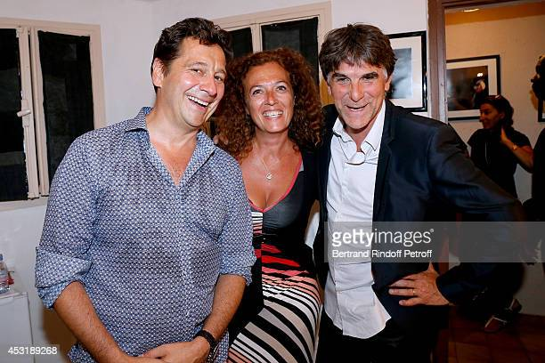 French impersonator Laurent Gerra poses backstage with JeanChristophe Le Texier alias Tex and his wife Beatrice after his show at the 30th Ramatuelle...