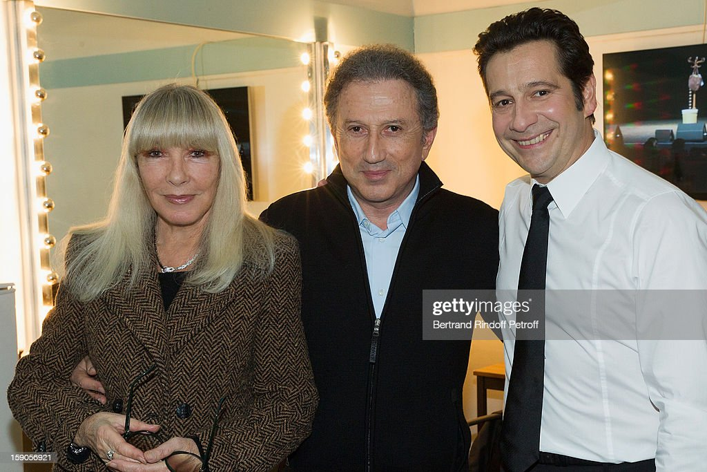 French impersonator Laurent Gerra (R) poses in his dressing room with Michel Drucker (C) and Drucker's wife Dany Saval following his one man show at Olympia hall on January 3, 2013 in Paris, France.