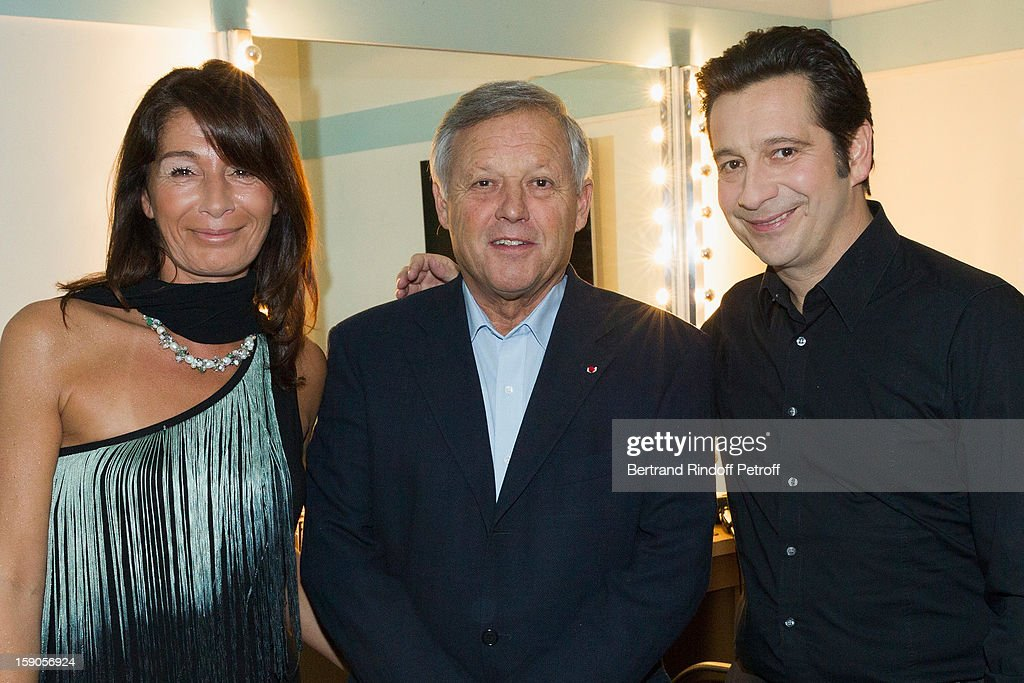 French impersonator Laurent Gerra (R) poses in his dressing room with French chef Georges Blanc (C) and Blanc's wife Sally following his one man show at Olympia hall on January 3, 2013 in Paris, France.