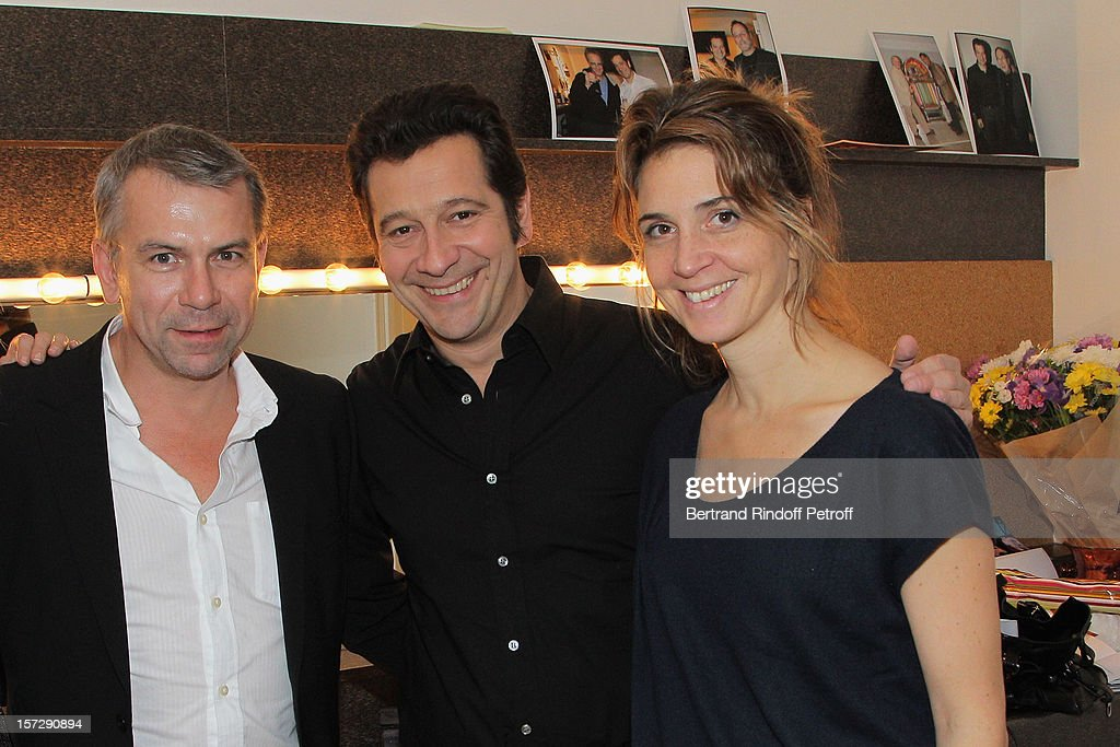 French impersonator Laurent Gerra (C) poses with actor Philippe Torreton (L) and Torreton's wife Elsa Boublil, in Gerra's dressing room prior to his One Man Show at Palais des Congres on November 29, 2012 in Paris, France.