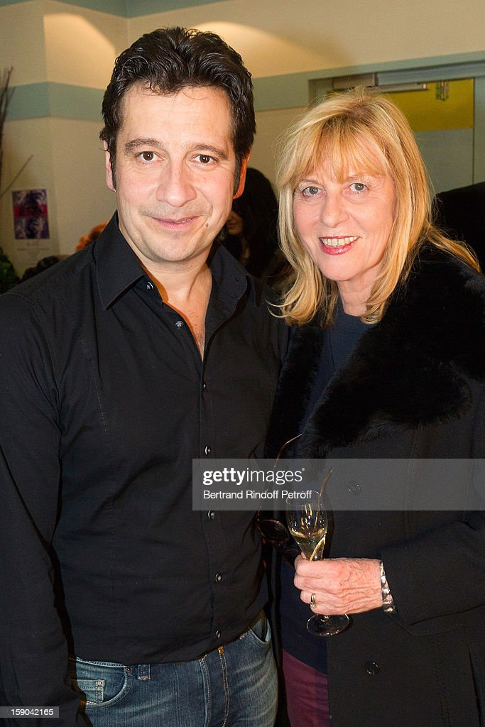 French impersonator Laurent Gerra (L) poses with Chantal Ladesou ain his dressing room following Gerra's one man show of at Olympia hall on January 4, 2013 in Paris, France.