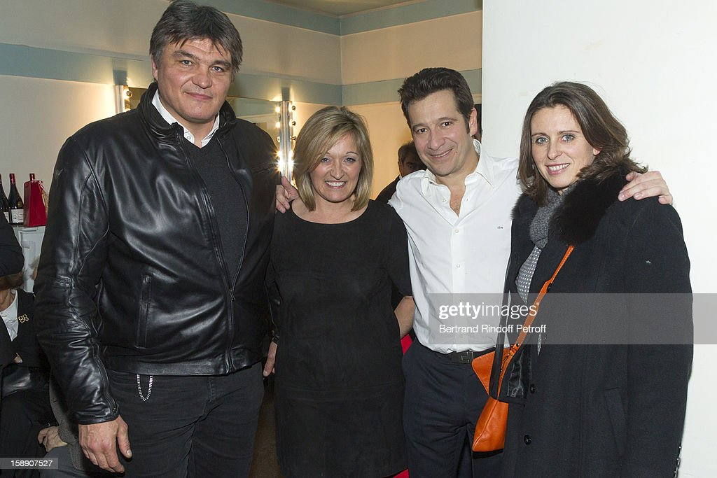 French impersonator Laurent Gerra (3rd L) poses with (L-R) David Douillet, Douillet's wife Valerie and guest following his one man show at Olympia hall on December 18, 2012 in Paris, France.