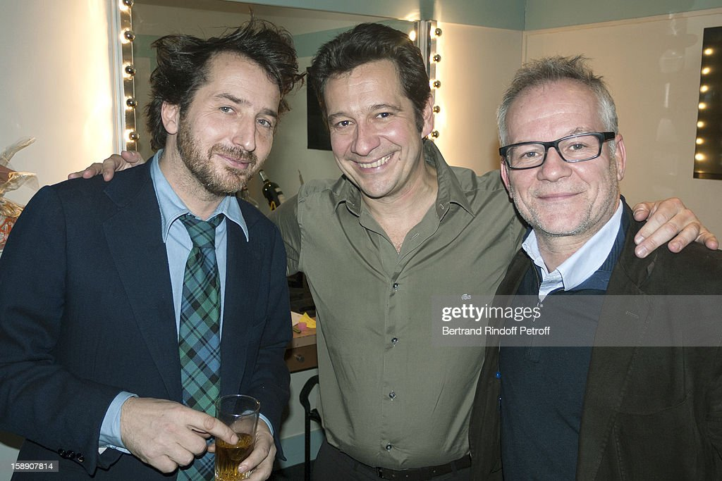 French impersonator Laurent Gerra (C) poses with Edouard Baer (L) and Thierry Fremaux in Gerra's dressing room following his one man show at Olympia hall on December 25, 2012 in Paris, France.