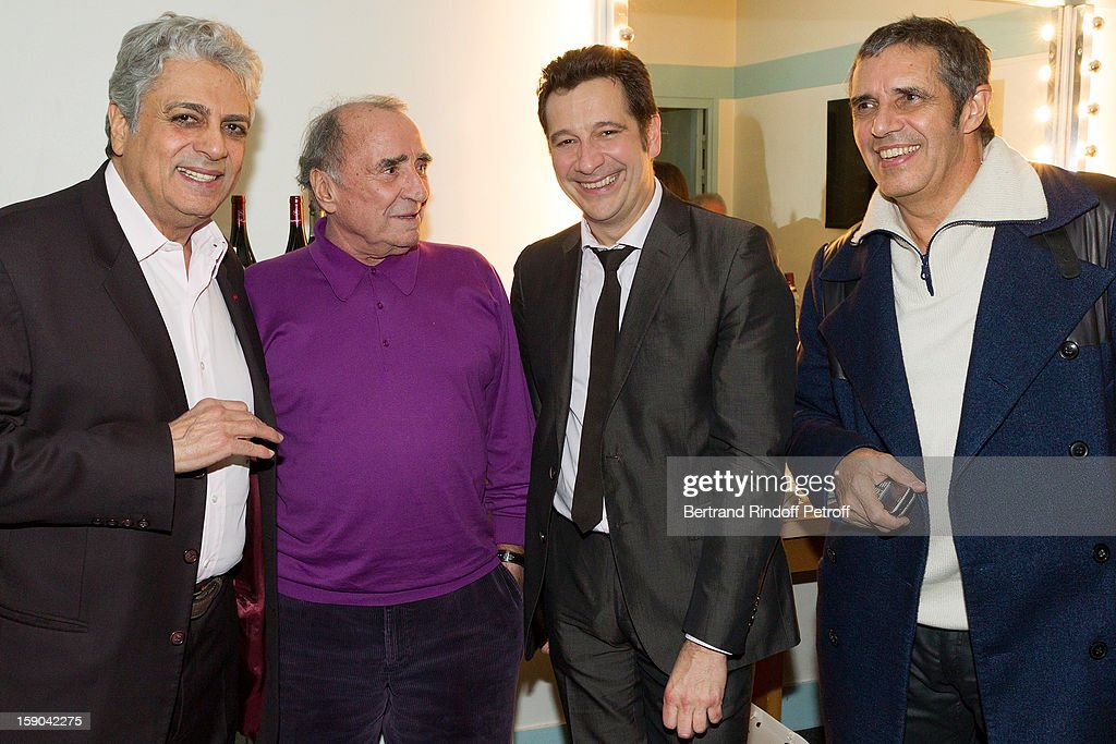 French impersonator Laurent Gerra (3rd L) poses with (L-R) Enrico Macias, Claude Brasseur and Julien Clerc in his dressing room following his one man show at Olympia hall on January 5, 2013 in Paris, France.