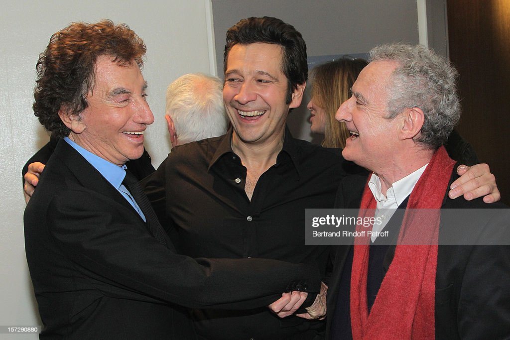 French impersonator Laurent Gerra (C) poses with former French Culture Minister Jack Lang (L) and humorist Daniel Prevost in Gerra's dressing room following his One Man Show at Palais des Congres on November 28, 2012 in Paris, France.