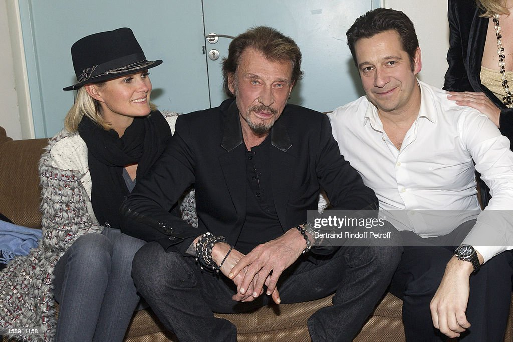 PARIS, FRANCE - DECEMBER 21 : (EXCLUSIVE COVERAGE) (EDITORS NOTE - THIS IMAGE HAS BEEN DIGITALLY MANIPULATED) French impersonator Laurent Gerra (R) poses with French rocker Johnny Hallyday (C) and Hallyday's wife Laeticia following Gerra's one man show at Olympia hall on December 21, 2012 in Paris, France.