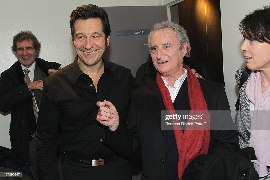 French impersonator Laurent Gerra (2nd L) poses with humorist Daniel Prevost (3rd L) and Prevost's wife (R), in Gerra's dressing room following his One Man Show at Palais des Congres on November 28, 2012 in Paris, France.