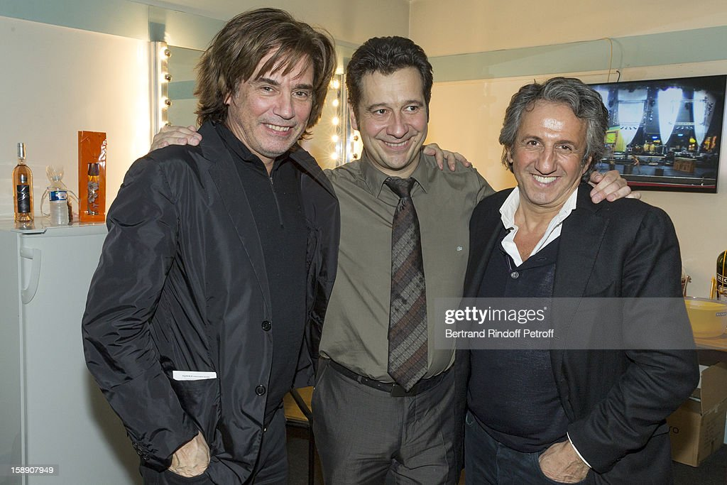 French impersonator Laurent Gerra (C) poses with Jean-Michel Jarre (L) and Richard Anconina, in his dressing room following his one man show at Olympia hall on December 28, 2012 in Paris, France.