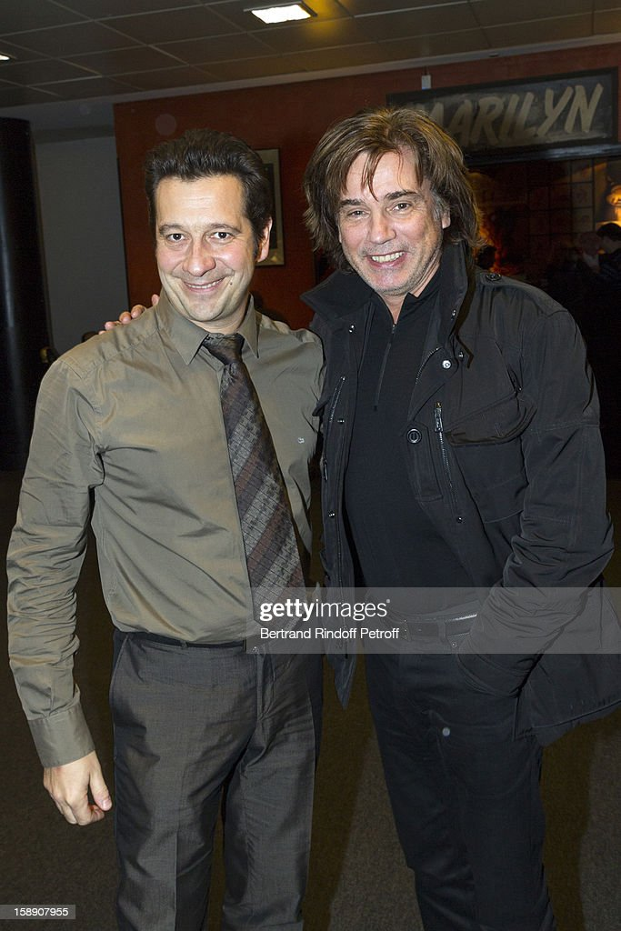 French impersonator Laurent Gerra (L) poses with Jean-Michel Jarre following his one man show at Olympia hall on December 28, 2012 in Paris, France.