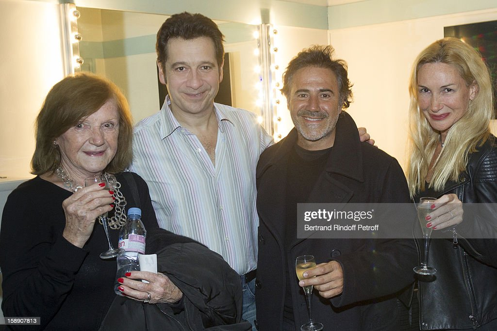 French impersonator Laurent Gerra (2nd L) poses with Jose Garcia (3rd L), Garcia's wife Isabelle Doval (R) and Doval's mother in Gerra's dressing room following his one man show at Olympia hall on December 22, 2012 in Paris, France.