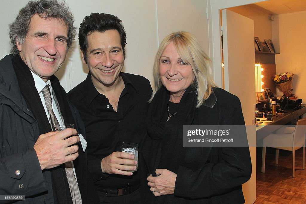 French impersonator Laurent Gerra (C) poses with journalist Gerard Leclerc (L) and Leclerc's wife Julie in Gerra's dressing room following his One Man Show at Palais des Congres on November 28, 2012 in Paris, France.