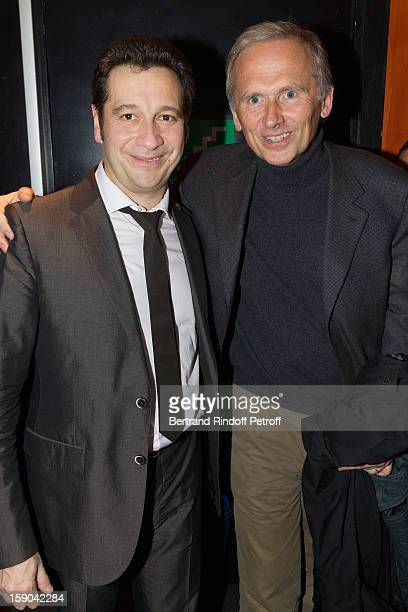 French impersonator Laurent Gerra (L) poses with Thomas Valentin, Vice-Chairman of the Board of the M6 Group, following Gerra's one man show at Olympia hall on January 5, 2013 in Paris, France.