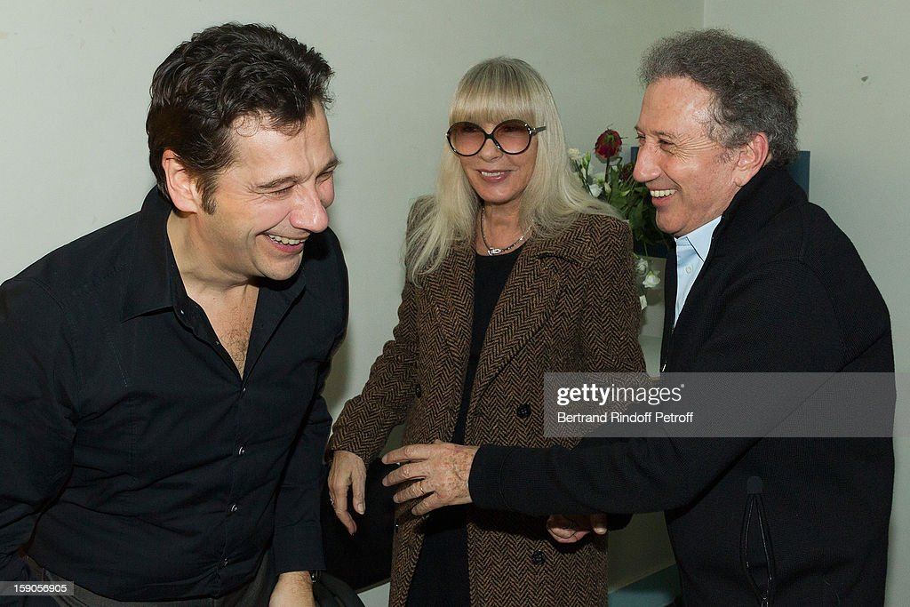 French impersonator Laurent Gerra (L) shares a light moment in his dressing room with Michel Drucker (R) and Drucker's wife Dany Saval following his one man show at Olympia hall on January 3, 2013 in Paris, France.