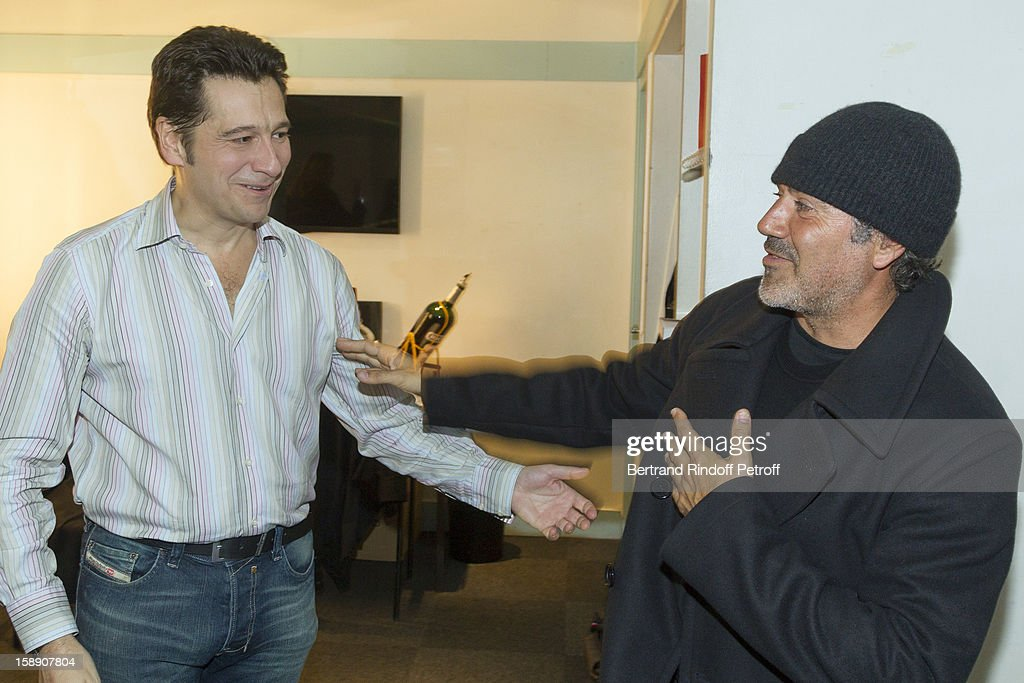 French impersonator Laurent Gerra (L) shares a light moment with Jose Garcia in Gerra's dressing room following his one man show at Olympia hall on December 22, 2012 in Paris, France.