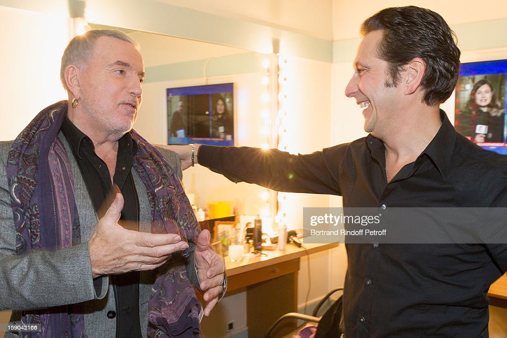 French impersonator Laurent Gerra (R) talks with singer Bernard Lavilliers, in his dressing room following his one man show at Olympia hall on January 4, 2013 in Paris, France.