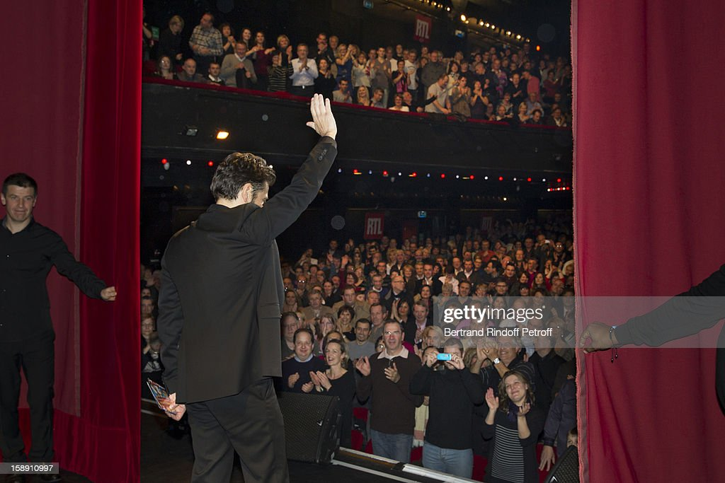 French impersonator Laurent Gerra (C), who turned 45 on December 29, acknowledges applause at the end of his one man show, after he celebrated his birthday on stage, at Olympia hall on December 29, 2012 in Paris, France.