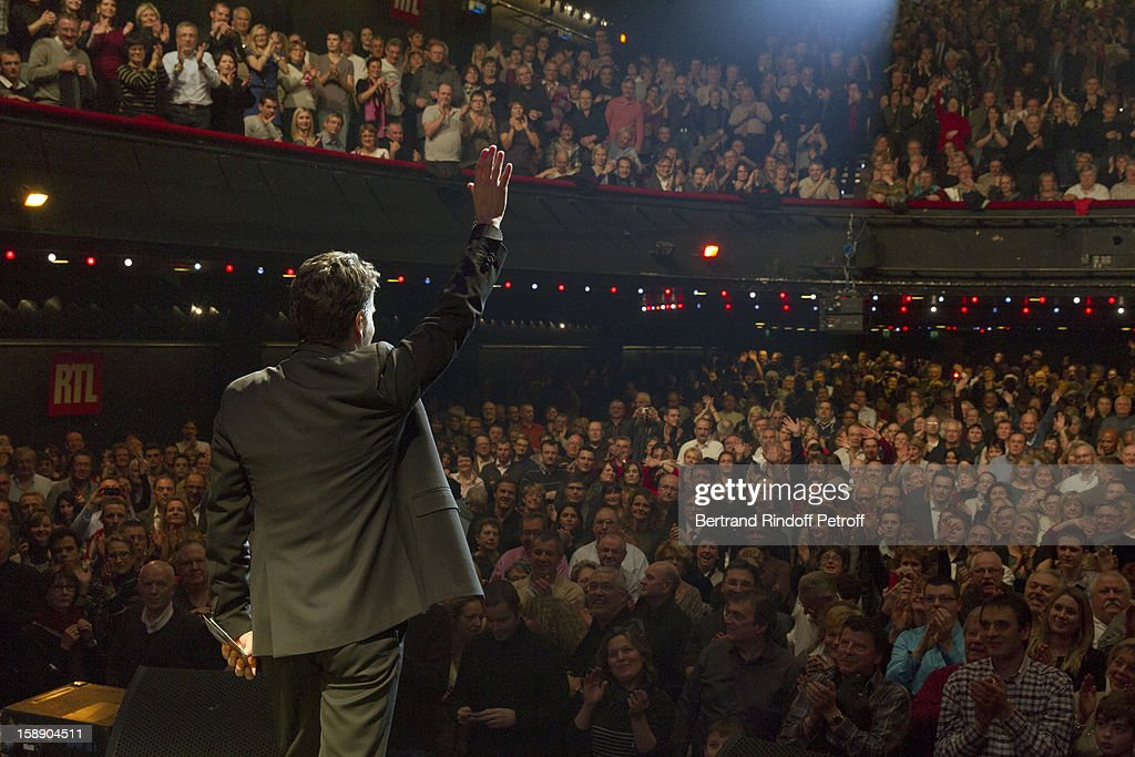 French impersonator Laurent Gerra, who turned 45 on December 29, acknowledges applause on stage following his one man show at Olympia hall on December 29, 2012 in Paris, France.