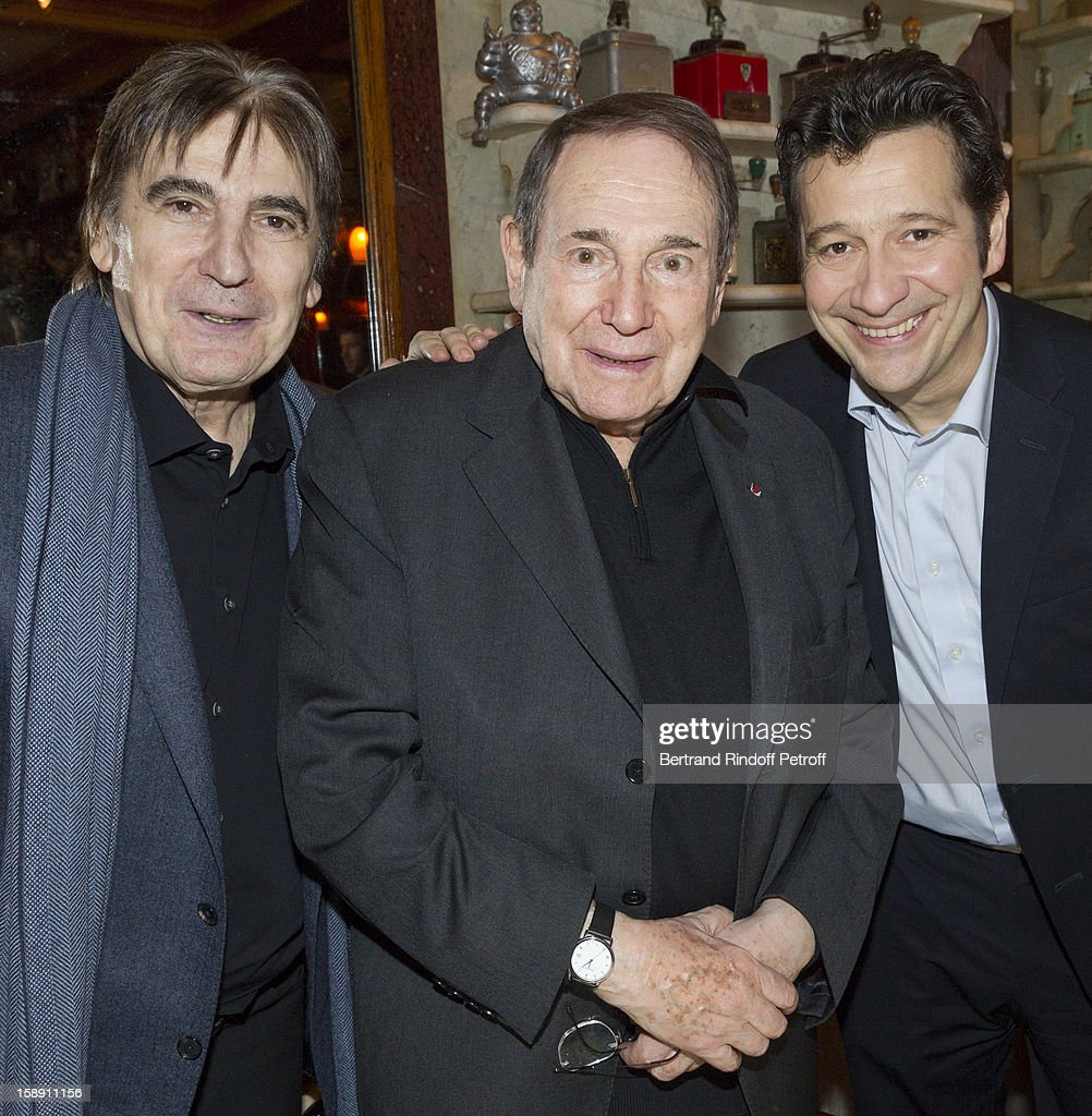 French impersonator Laurent Gerra (C), who turned 45 on December 29, poses with Serge Lama (L), and Robert Hossein, who turned 85 the same day, as Gerra and Hossein celebrate their birthday together at Michel Rostang's restaurant 'Le Flaubert, un bistrot d'a cote', after Gerra's one man show at Olympia hall on December 29, 2012 in Paris, France.