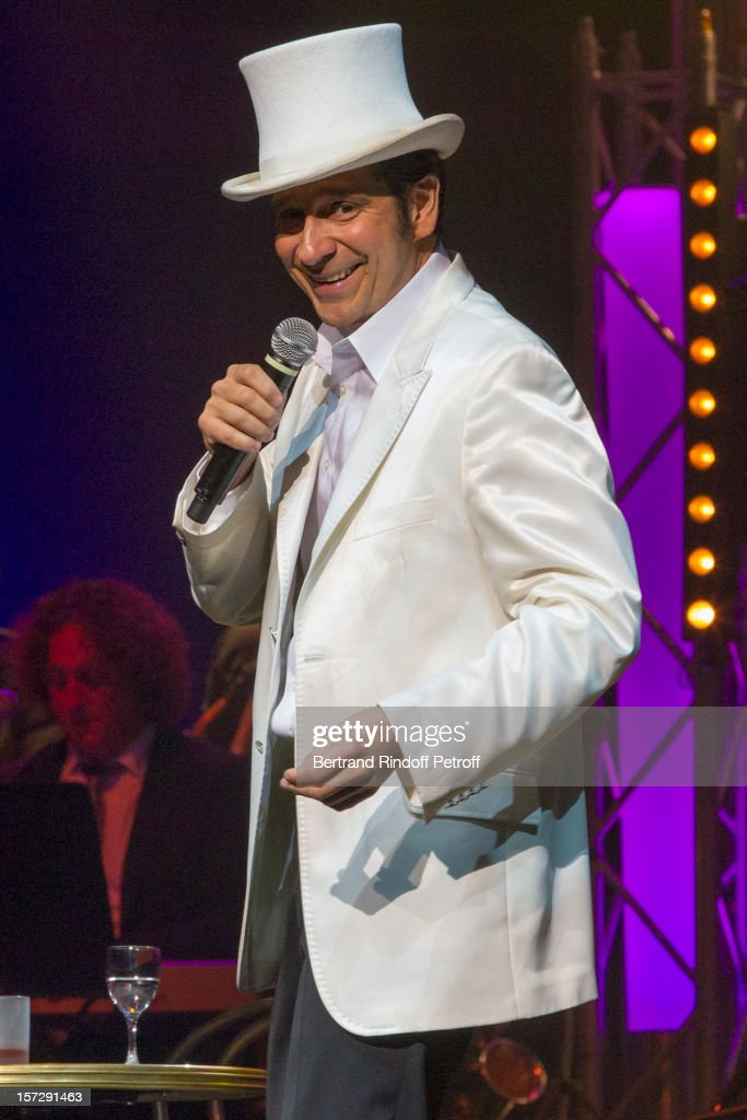 French impersonator Laurent <a gi-track='captionPersonalityLinkClicked' href=/galleries/search?phrase=Laurent+Gerra&family=editorial&specificpeople=538435 ng-click='$event.stopPropagation()'>Laurent Gerra</a> imitates singer Henri Salvador during his One Man Show at Palais des Congres on November 28, 2012 in Paris, France.
