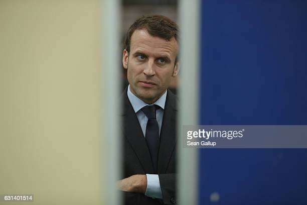 French independent presidential candidate Emmanuel Macron chats learns about a training program for refugees at a train repair facility of German...