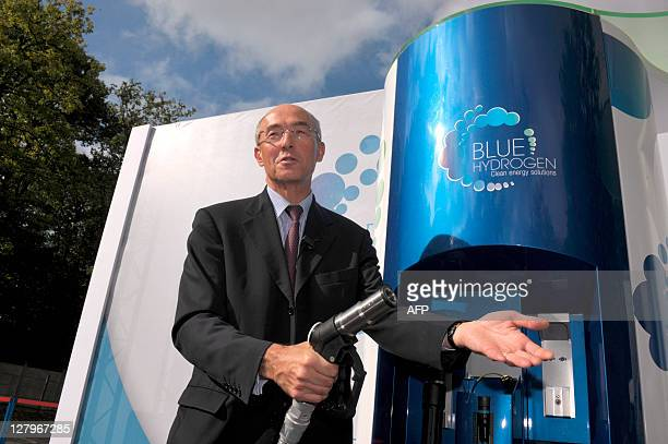 French industrial gas group Air Liquide chief executive Benoit Potier poses near an hydrogen filling station during a presentation of Hydrogen...