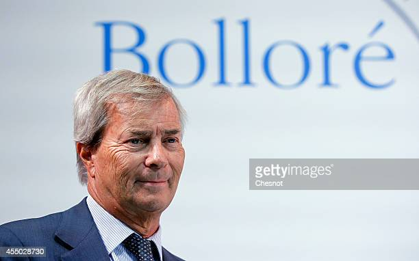 French industrial group Bollore head Vincent Bollore attends a press conference with CEO of French carmaker Renault Carlos Ghosn at the Atelier...