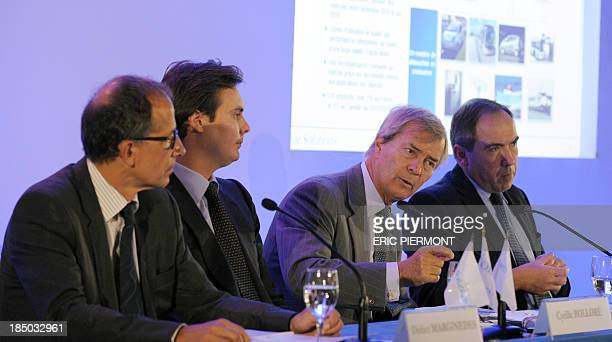 French Industrial group Bollore's head Vincent Bollore flanked by his son and ViceChairman Managing Director Cyrille Bollore BlueSolutions vice...