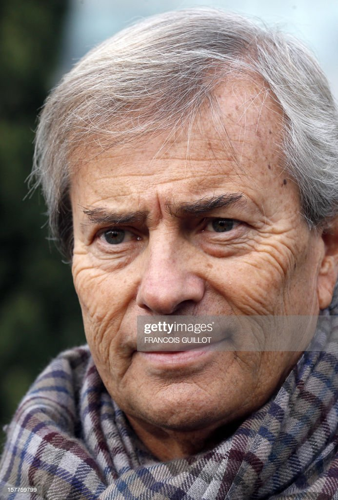French industrial group Bollore's head, Vincent Bollore looks on after giving a joint press conference with the CEO of the IT services company Atos, on December 6, 2012 in Bezons, north of Paris, announcing the launching of My Car, the first Atos electric car fleet powered by solar panels. AFP PHOTO FRANCOIS GUILLOT
