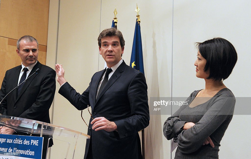 French Industrial Renewal Minister Arnaud Montebourg speaks to the press next to French Junior Minister for SMEs, Innovations and Digital Economy Fleur Pellerin and National Mediator inter-Entreprises Pierre Pelouzet at the French Ministry in Paris on December 18, 2012 prior to the signing of a charter committing companies to help innovations and to support innovative SMEs in their sector .