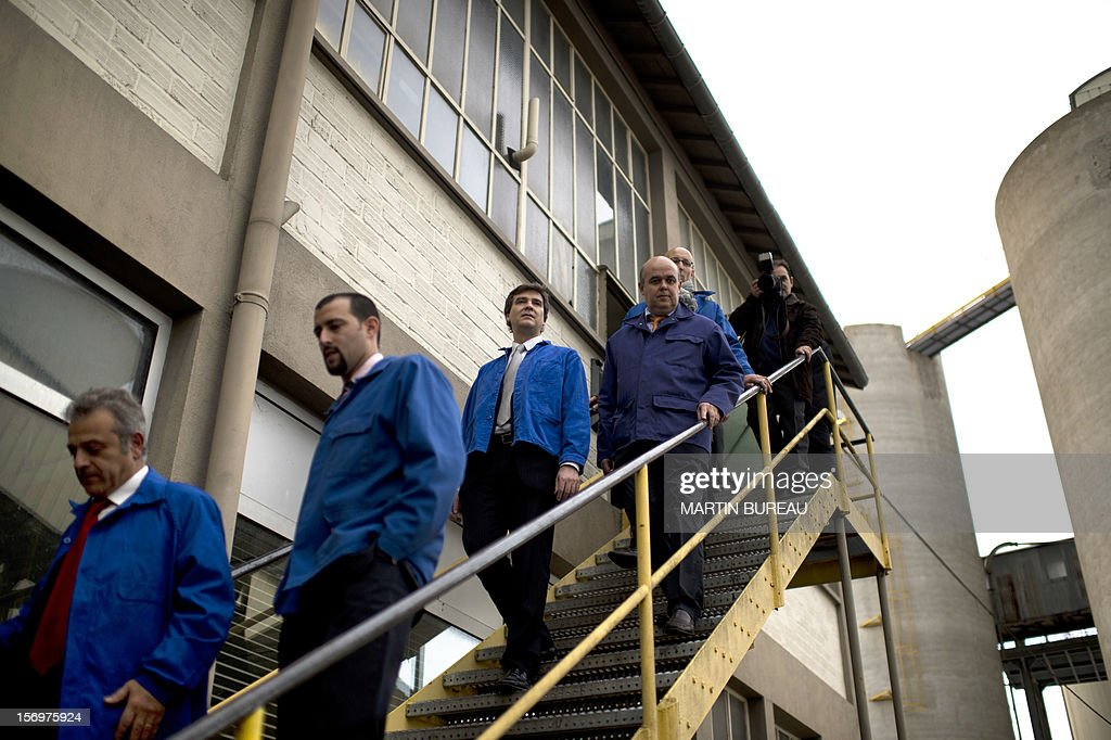 French Industrial Renewal Minister Arnaud Montebourg (C) walks down stairs as he visits the factory of French manufacturer of glassware Duralex, on November 26, 2012 in La Chapelle-Saint-Mesmin. Montebourg does not want steel giant ArcelorMittal in France anymore and is looking for an industrial partner with which to take the group's operations there over on a temporary basis, he said on November 26 in an interview.
