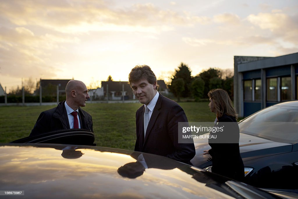 French Industrial Renewal Minister Arnaud Montebourg (C) walks to his car after he visited the factory of French manufacturer of glassware Duralex, on November 26, 2012 in La Chapelle-Saint-Mesmin. Montebourg does not want steel giant ArcelorMittal in France anymore and is looking for an industrial partner with which to take the group's operations there over on a temporary basis, he said on November 26 in an interview.