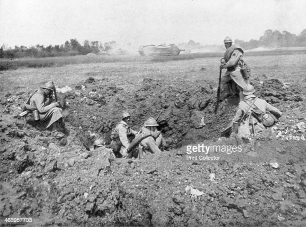 French infantry resting in a shell hole Chemin des Dames France 11 June 1918 A strategically important ridge overlooking the River Aisne the Chemin...