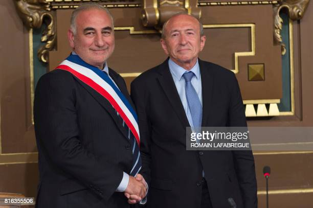 French Interior Minister and former Mayor of Lyon Gerard Collomb and new Mayor of Lyon Georges Kepenekian shakes hand during the city council in...