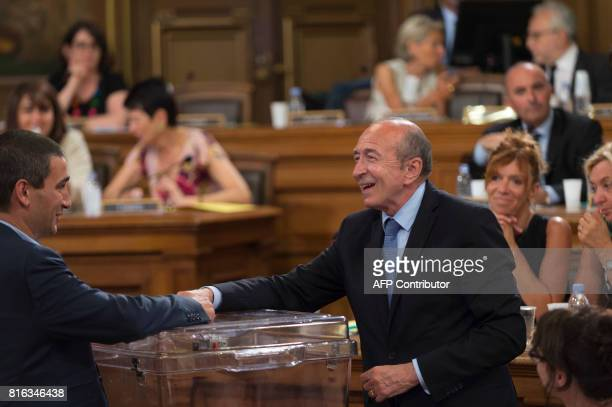 French Interior Minister and former Mayor of Lyon Gerard Collomb votes to elect the new Mayor of Lyon during the city council at the city hall in...