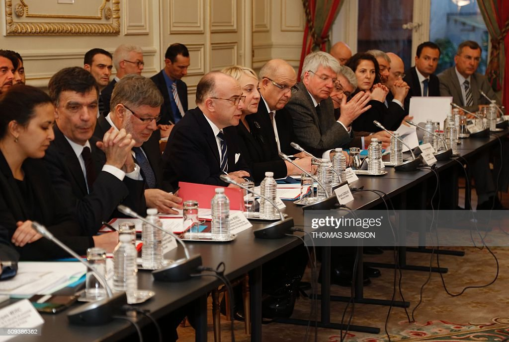 French Interior minister Bernard Cazeneuve (4th L) and French junior minister for Transport, Maritime Economy and Fishery Alain Vidalies (3rd L) attend a special meeting of the Public Transport National Security Committee on the Ile-de -France region at the Hotel Beauvau in Paris, on February 10, 2016. AFP PHOTO / THOMAS SAMSON / AFP / THOMAS SAMSON