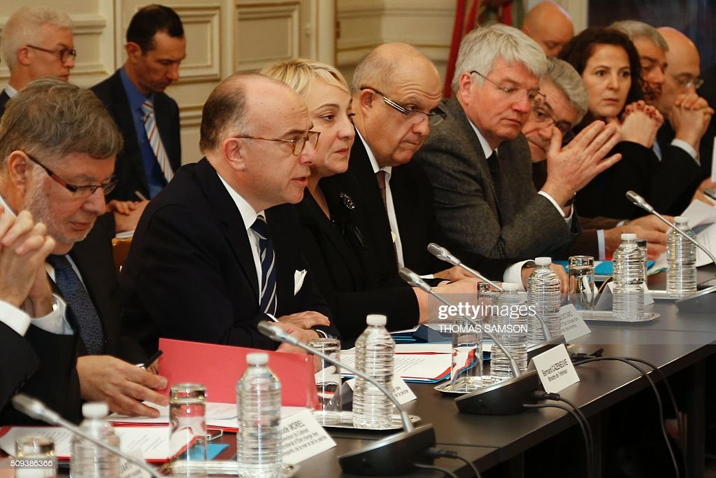 French Interior minister Bernard Cazeneuve (2nd L) and French junior minister for Transport, Maritime Economy and Fishery Alain Vidalies (1st L) attend a special meeting of the Public Transport National Security Committee on the Ile-de -France region at the Hotel Beauvau in Paris, on February 10, 2016. AFP PHOTO / THOMAS SAMSON / AFP / THOMAS SAMSON