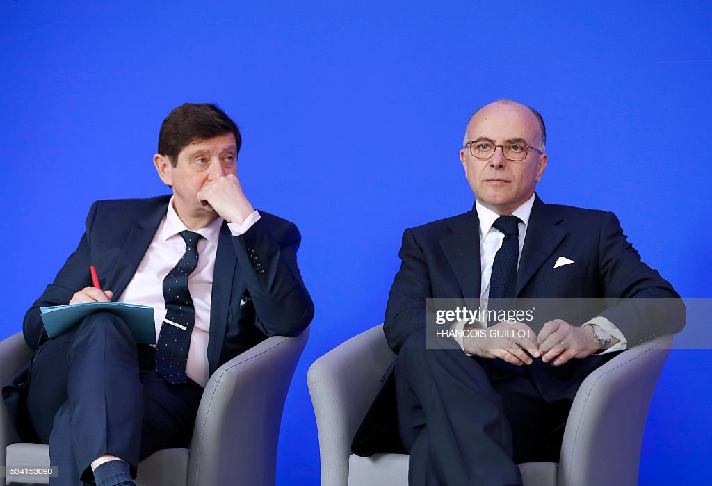 French Interior minister Bernard Cazeneuve (R) and French minister for Cities, Youth and Sport Patrick Kanner (L) attends a press conference on security measures for the Euro 2016, in Paris on May 25, 2016. France said on May 25, 2016 that it will deploy more than 90,000 police and security guards for Euro 2016, vowing to do 'everything possible to avoid a terrorist attack' during the football tournament that starts next month. / AFP / FRANCOIS