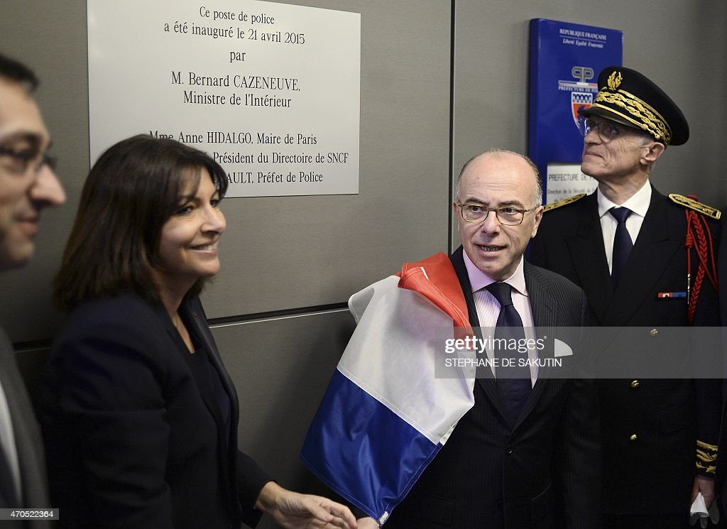 French Interior Minister <a gi-track='captionPersonalityLinkClicked' href=/galleries/search?phrase=Bernard+Cazeneuve&family=editorial&specificpeople=4205153 ng-click='$event.stopPropagation()'>Bernard Cazeneuve</a> (2ndR) and Paris' mayor <a gi-track='captionPersonalityLinkClicked' href=/galleries/search?phrase=Anne+Hidalgo&family=editorial&specificpeople=590989 ng-click='$event.stopPropagation()'>Anne Hidalgo</a> (2ndL) unveil an inauguration plaque for a new police station at the Gare du Nord train station, on April 21, 2015 in Paris, next to Paris police Prefect <a gi-track='captionPersonalityLinkClicked' href=/galleries/search?phrase=Bernard+Boucault&family=editorial&specificpeople=7772884 ng-click='$event.stopPropagation()'>Bernard Boucault</a> (R). AFP PHOTO / STEPHANE DE SAKUTIN