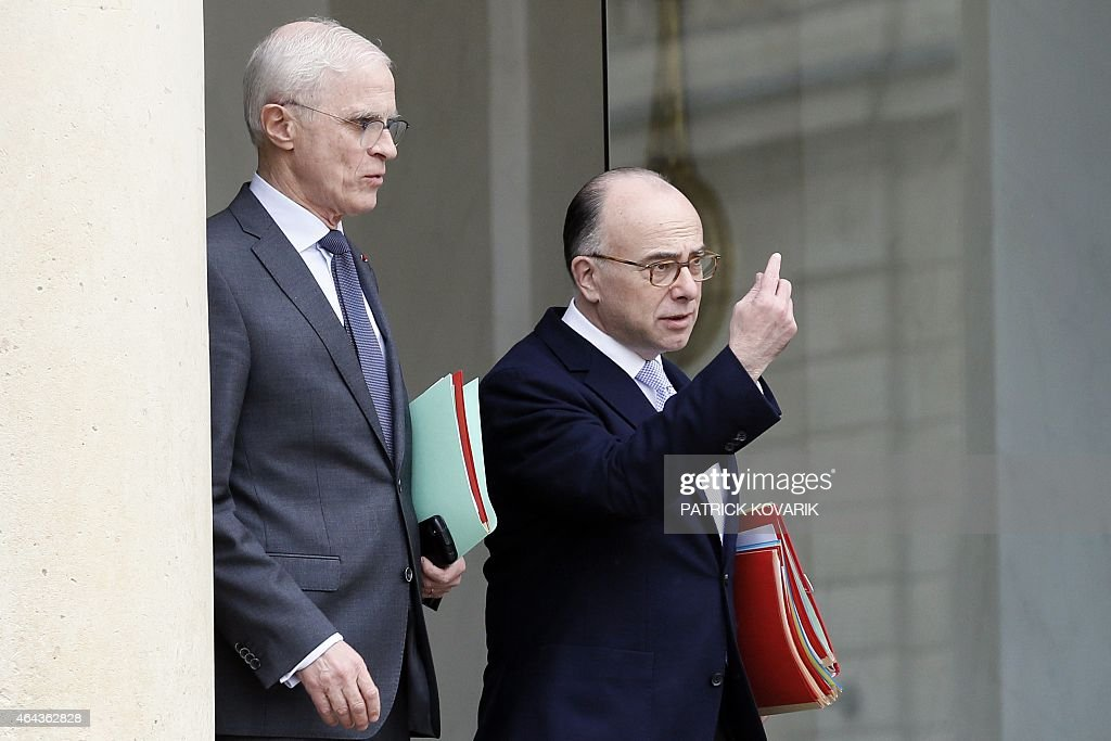 French Interior minister <a gi-track='captionPersonalityLinkClicked' href=/galleries/search?phrase=Bernard+Cazeneuve&family=editorial&specificpeople=4205153 ng-click='$event.stopPropagation()'>Bernard Cazeneuve</a> (R) and Paris police Prefect <a gi-track='captionPersonalityLinkClicked' href=/galleries/search?phrase=Bernard+Boucault&family=editorial&specificpeople=7772884 ng-click='$event.stopPropagation()'>Bernard Boucault</a> leave the weekly cabinet meeting at the Elysee Palace, on February 25, 2015 in Paris. AFP PHOTO / PATRICK KOVARIK
