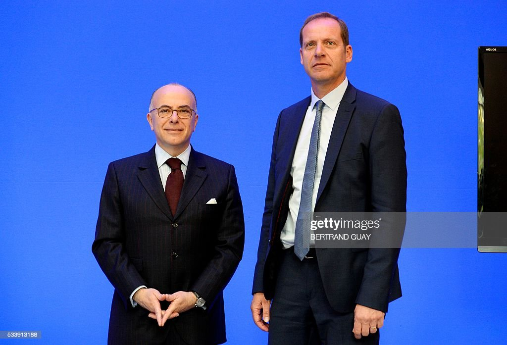 French Interior Minister Bernard Cazeneuve (L) and Tour de France race director Christian Prudhomme pose ahead of a press conference about security during the Tour de France cycling race on May 24, 2016, in Paris. / AFP / BERTRAND
