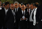 TOPSHOT French Interior Minister Bernard Cazeneuve arrives to speak to the media in Nice early on July 15 2016 as he visits the area where a truck...