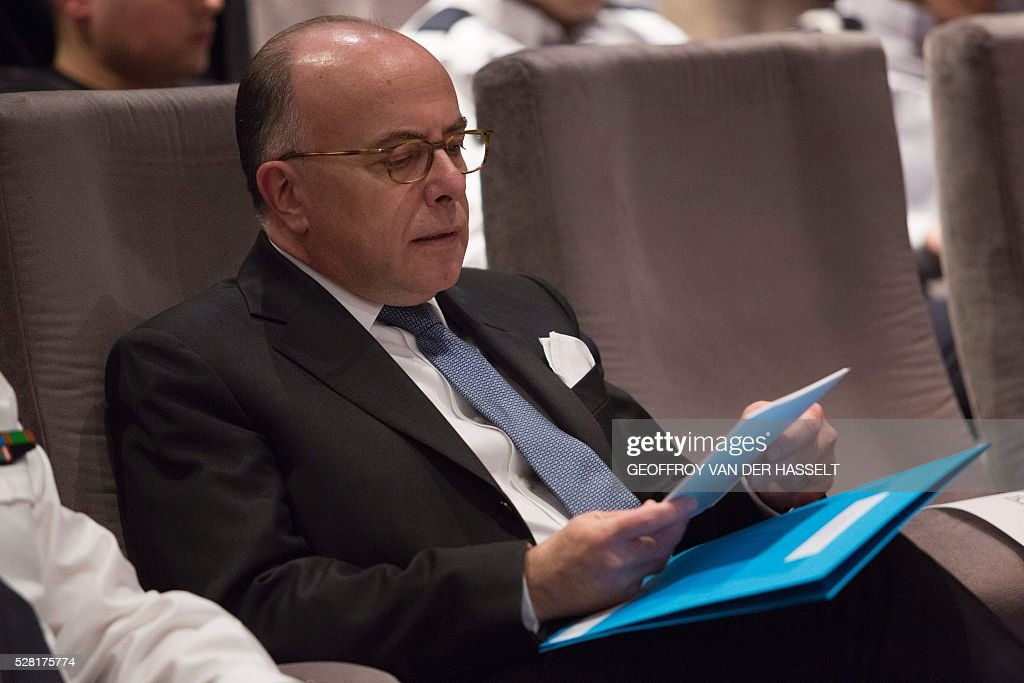 French Interior minister Bernard Cazeneuve attends the presentation of the French police (Police Nationale) new recruitment campaign, on May 4, 2016 in Paris. / AFP / Geoffroy Van der Hasselt