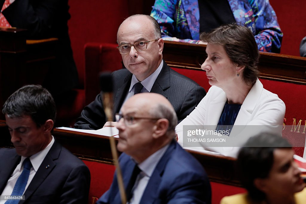 French Interior minister Bernard Cazeneuve (top L) attends the questions to the government session on June 29, 2016 at the French National Asssembly in Paris. / AFP / Thomas SAMSON